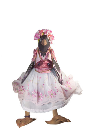 Magpie handmade in a sundress and a wreath on her head Stock Photo