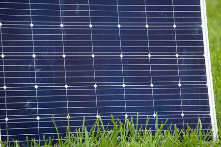 large solar panel stands on the grass