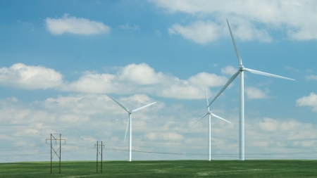 Windfarm in a green prairie against a blue sky  photo