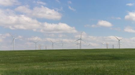 windfarm: Windfarm in a green prairie with against a blue sky. Stock Photo