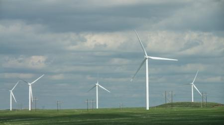 windfarm: Windfarm in a green prairie against a cloudy sky.