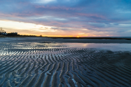 Colorful Cape Cod sunset with sand ripples