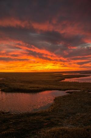 Colorful sunset over Cape Cod Bay and marshes