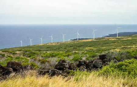 Eight windmills on the green slopes of Haleakala on the island of Maui, Hawaii