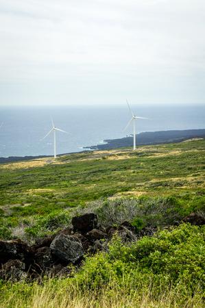 Two windmills on the green slopes of Haleakala on the island of Maui, Hawaii