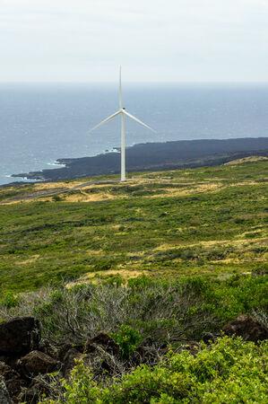 One windmill on the green slopes of Haleakala on the island of Maui, Hawaii Stock Photo