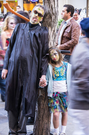 denver 16th street mall: Zombie Father and Duaghter invade the 16th St. Mall in Denver, Colorado on October 19, 2013