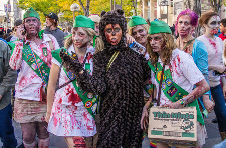denver 16th street mall: Zombie Girl Scouts invade the 16th St. Mall in Denver, Colorado on October 19, 2013