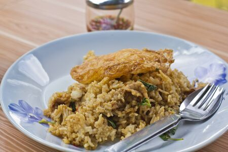 Basil fried rice with pork and fried egg  photo