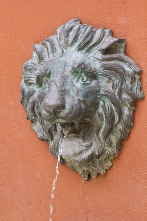 lionhead: Stone lionhead statue on the wall