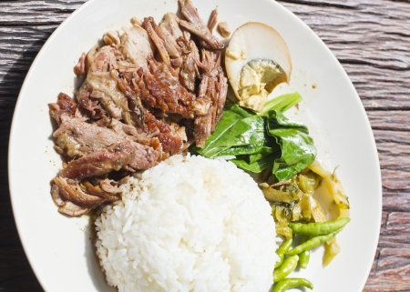 Thai stewed pork knuckles with rice