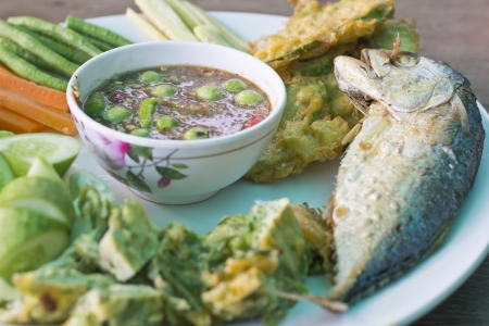 Shrimp paste with fried mackerel and vegetable photo