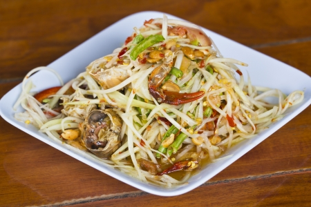 Thai papaya salad with salted crab photo