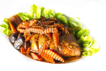 Stewed red tilapia fish and vegetables with salty soup Stock Photo - 15360854