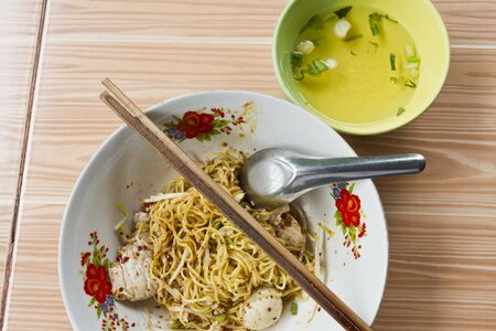 Egg noodle with pork and fish ball photo