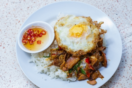 Basil stewed pork  with fried egg in Thailand