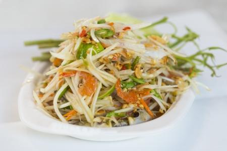Thai spicy papaya salad with salted crab photo