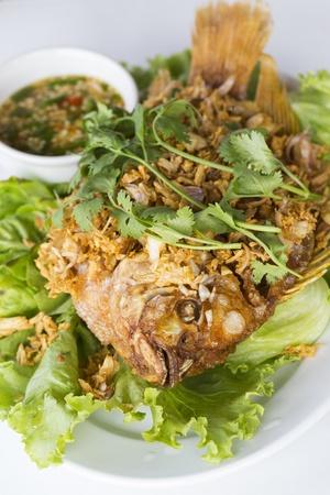 Deep fried red tilapia fish with crispy garlic photo