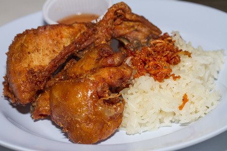 Thai fried chicken and sticky rice photo
