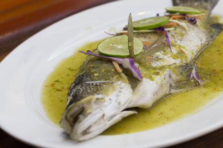bass fish: Steamed seabass In Thai lemon sauce