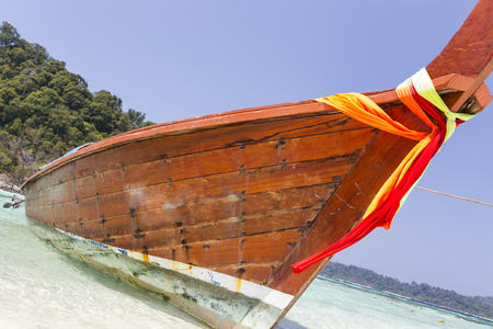 Traditional longtail boat on the beach at Lipe island, Thailand photo