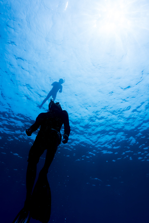 Freediver dives at Surin national park, Thailand