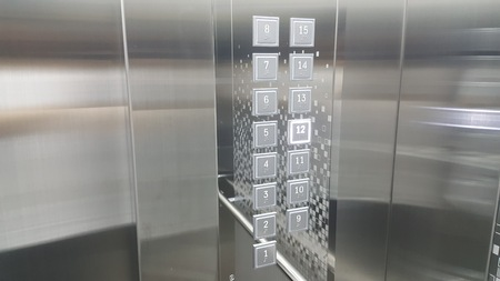 A shiny new elevator and button