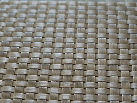 abstract textural brown background uniform wicker surface. High quality photo