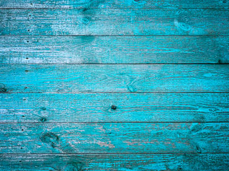 natural wood background, old shabby planks painted with turquoise paint, selective focus. High quality photo