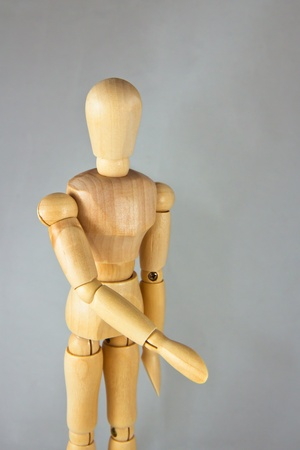 greets: a wooden mannequin give a hand, greets. isolated  Stock Photo