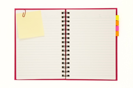 Red notebook isolated on white background photo
