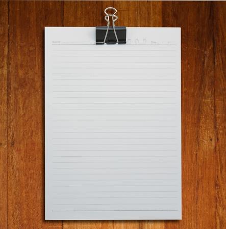 Black clip and White blank note paper on White background  Zdjęcie Seryjne