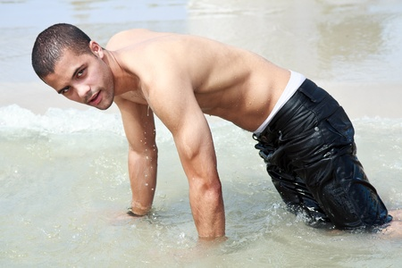 wet jeans: guy on the beach