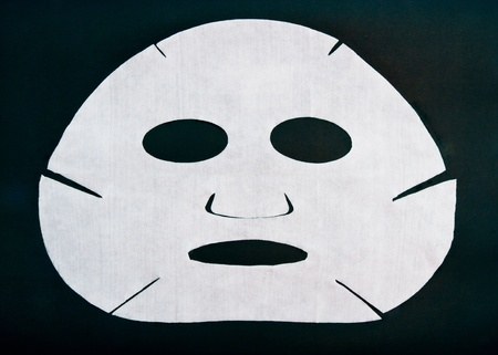 femme masqu�e: masque cosm�tique sur un fond noir Banque d'images