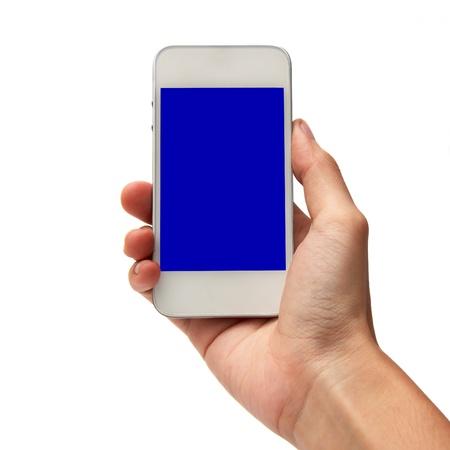 dialing: Mano que sostiene tel�fono inteligente en blanco Foto de archivo