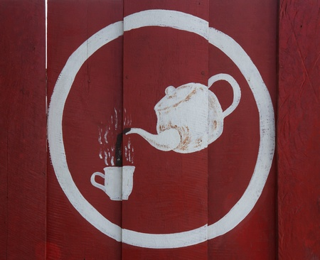 coffee pot and cup on red wood wall photo