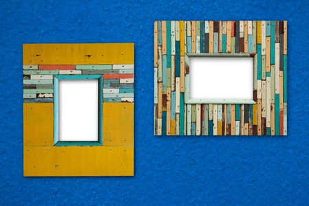 tableau: colorful picture frame on blue wall Stock Photo