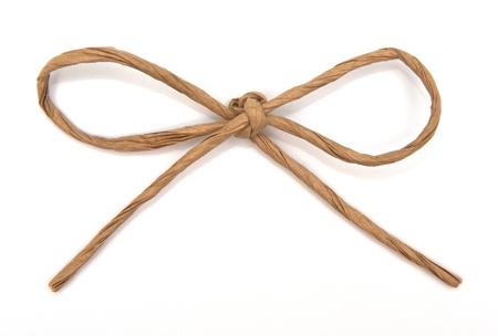 Ficelle attachée à un arc sur blanc Banque d'images - 12544357