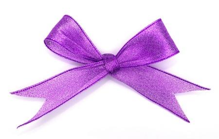lazo rosa: varios nudos de la cinta de seda sobre fondo blanco Foto de archivo