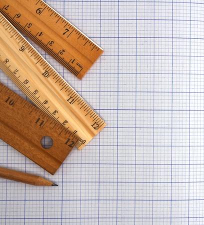 millimeter: Millimeter paper, ruler and pencil  Stock Photo