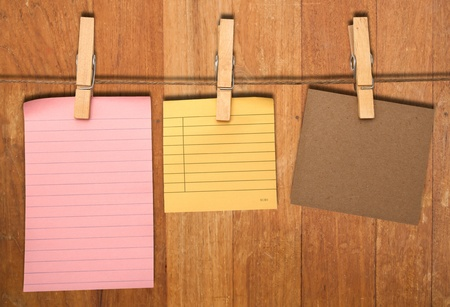 close up of post it reminders and clothespins attached to a rope  photo