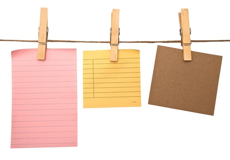 pegs: close up of post it reminders and clothespins attached to a rope