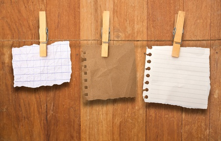 close up of a notes and a clothes pegs on wood wall Stock Photo - 12941594