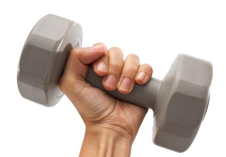 levantando pesas: Pesos de la mano de retenci�n contra el fondo blanco Foto de archivo