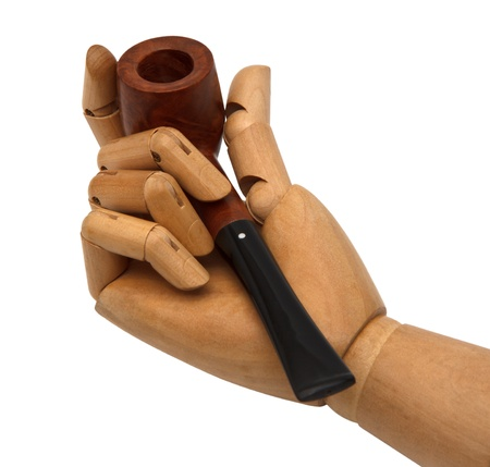 wooden hand and Tobacco pipe  photo