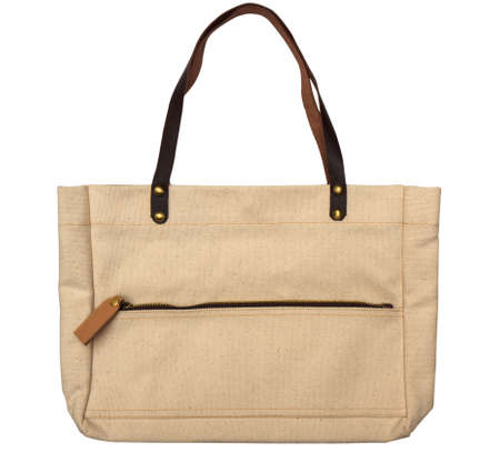 White cotton bag with leather zip fastener on white  photo