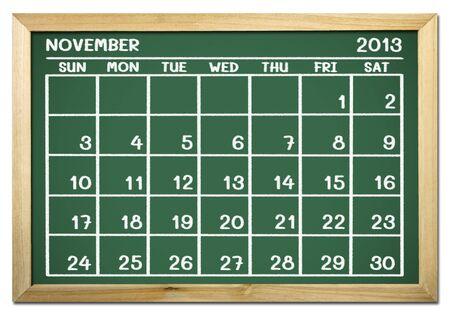 près d'un calendrier 2013 sur un tableau noir