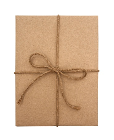 Brown paper package tied with string on a white background  photo