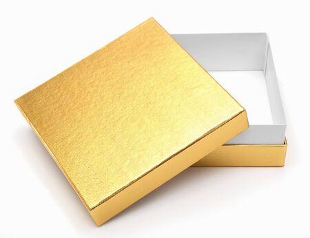 coffret cadeau en or sur un fond blanc Banque d'images