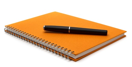notebook with pen isolated on white background  photo